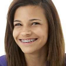 Young girl with braces smiling