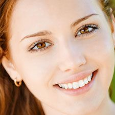 Young woman with brown eyes smiling