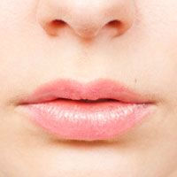 A close-up of a woman's plump lips