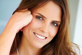 Brunette woman smiling following her cosmetic dentistry appointment