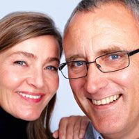 A middle-aged couple smiles together after visiting Ridgewood Dental Associates