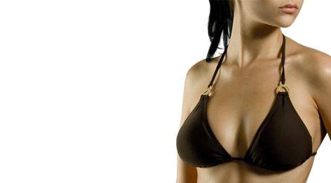 A woman's shapely bust in a bikini top.