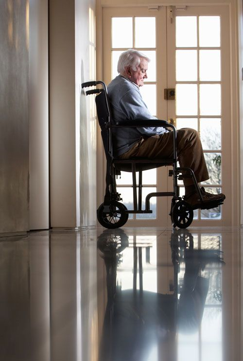 Sad-looking elderly man in wheelchair