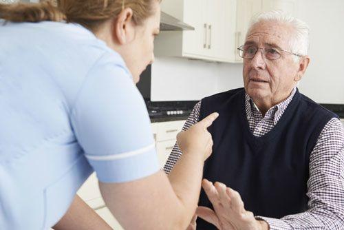 Nurse reprimanding nursing home resident