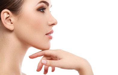 A woman's side profile showcases the effects of rhinoplasty