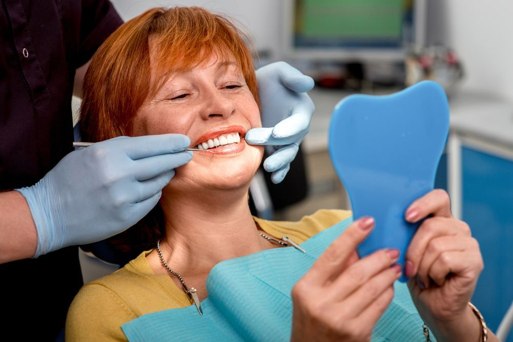 Photo of a woman smiling in the dentist's chair