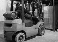 A forklift being operated in an unsafe manner.