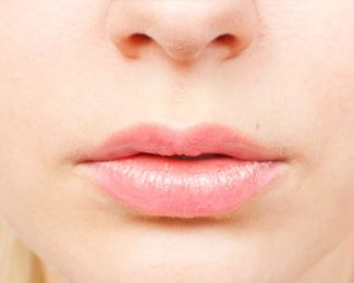 A closeup view of full, pink lips.