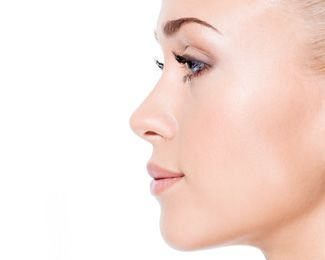 An up-close profile view of a white woman with very pale, youthful skin.