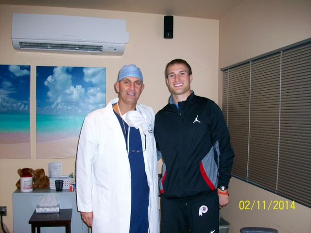 Dr. Holzman with Washington Redskins Quarterback Kirk Cousins