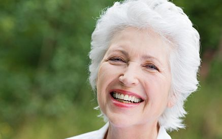 Smiling elderly woman with red lipstick