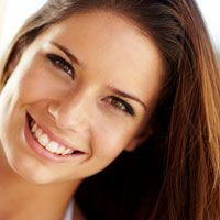 Young brunette female smiling