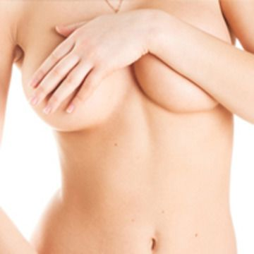 Photo of woman with arm over her breasts