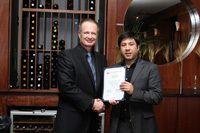 Dr. Jose Valenzuela, Jr. displays his certificate.