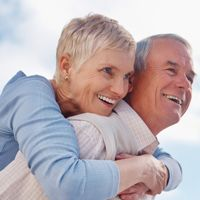 Photo of a smiling older couple embracing