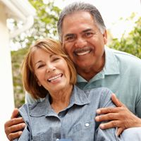 Photo of a smiling man and woman