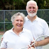 Photo of an older couple on a tennis court