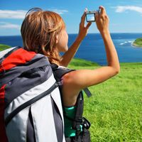 Photo of a woman in a backpack taking a photo