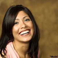 Laughing brunette in pink shirt
