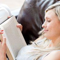 Blonde female reading a book