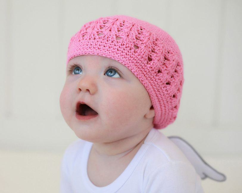 Photo of a baby in a pink hat