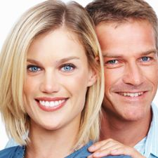 Man and woman smiling while wearing invisible braces