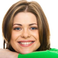 Adult female smiling while wearing customized orthodontics