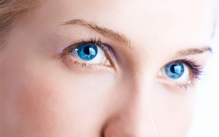 A woman's blue eyes after blepharoplasty surgery