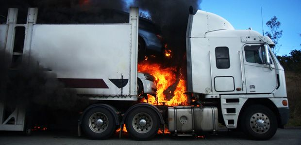Photo of a semi truck on fire