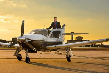 Photo of a man in a private plane