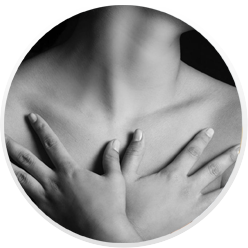 A woman covers her chest with her hands