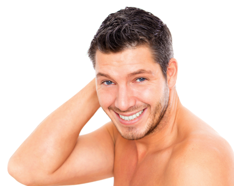 A handsome brunette main with blue eyes sits shirtless while holding his hand behind his head.