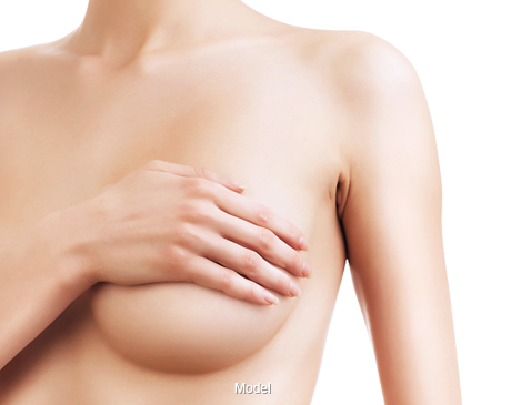 A woman covering her breast with her hand.