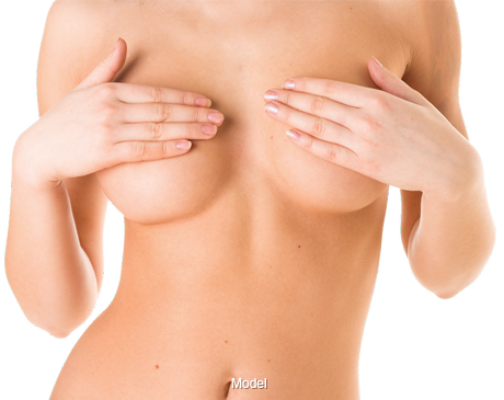 A naked woman's torso with hands covering breasts.