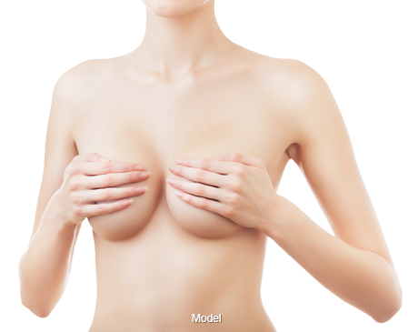 A woman covering her breasts with her hands.