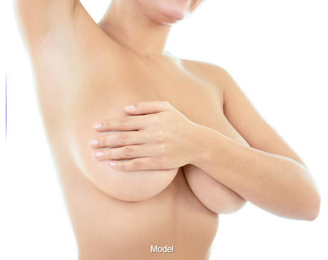 A woman holding both of her breasts with one arm.