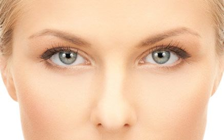 Close up of woman's brow area with smooth skin and blue eyes