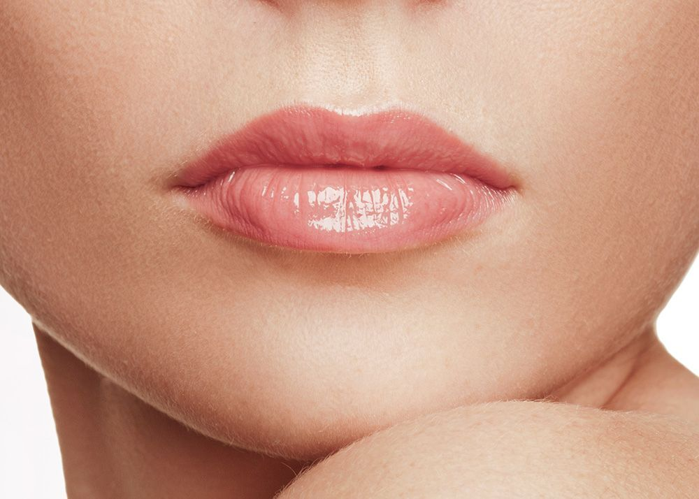 A close-up of a woman's full lips