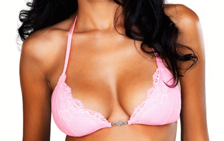 Woman's breasts in pink lacy halter-top bra