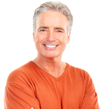 Elderly man with gray hair, wearing an orange shirt, smiling following hair loss treatment