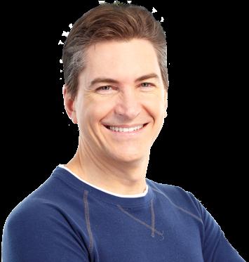 Man wearing blue shirt smiling following hair loss restoration
