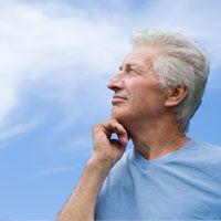 An older Caucasian man in contemplation