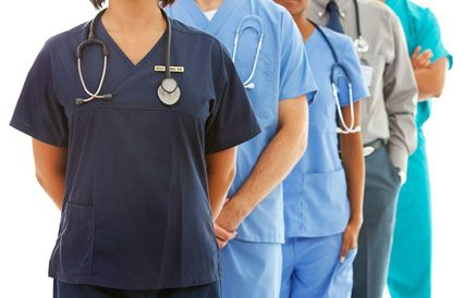A team of male and female nurses in scrubs