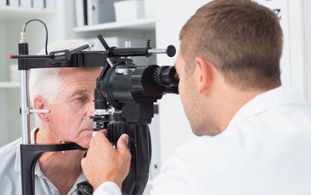 An elderly man undergoing an eye examination