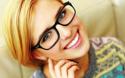 A young woman wearing glasses