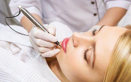 Woman having permanent makeup applied