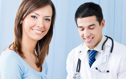 A young woman with a young male doctor
