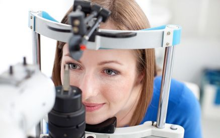 A young woman undergoing an eye examination