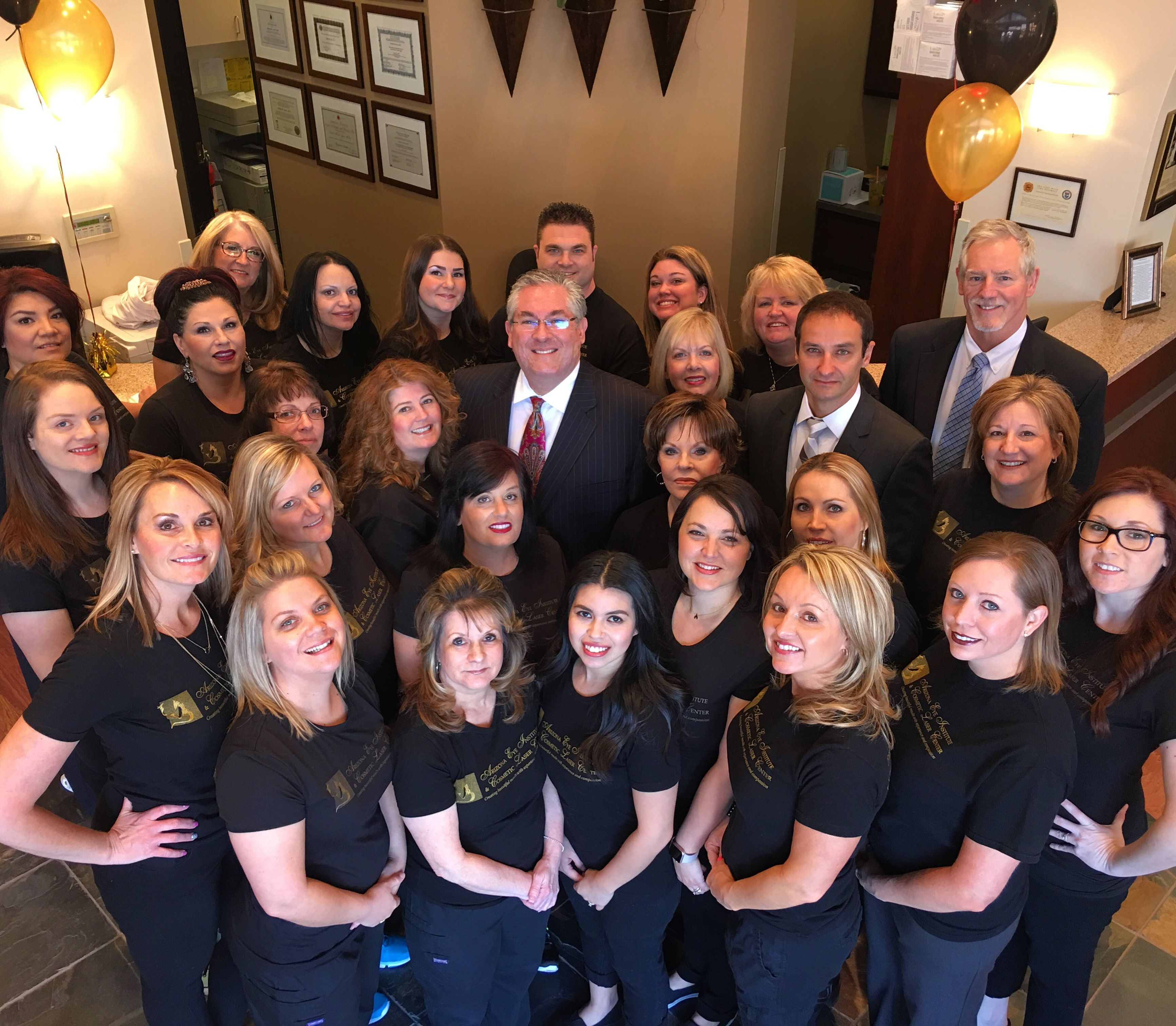 The doctors and staff, led by Dr. Emilio Justo, of the Arizona Eye Institute & Cosmetic Laser Center