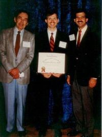 Photo of Dr. Szachowicz receiving an award